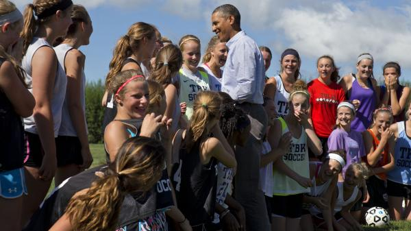 President Obama makes an unannounced stop to talk with the Tully Central High School soccer team about their plans for college in Tully, N.Y., on Friday.