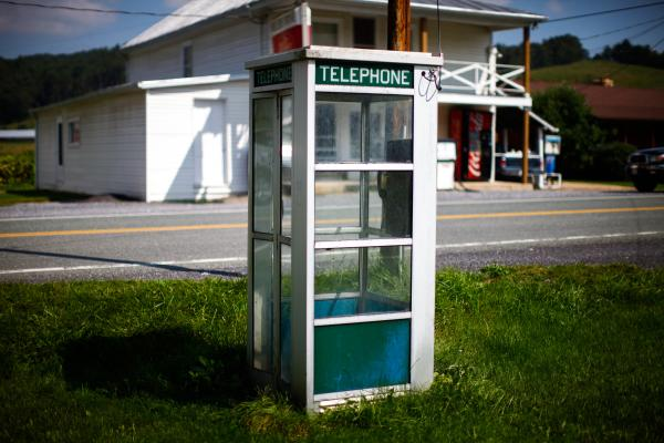A telephone booth sits by a road leading to the National Radio Astronomy Observatory in Green Bank, W.Va. Cell service around the telescope is nonexistent.