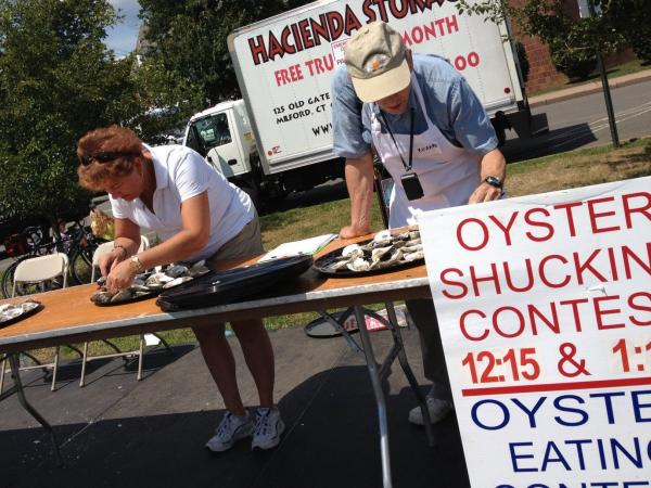 Connecticut's health exchange sent outreach workers to the Milford Oyster Festival to get people to sign up for health insurance.