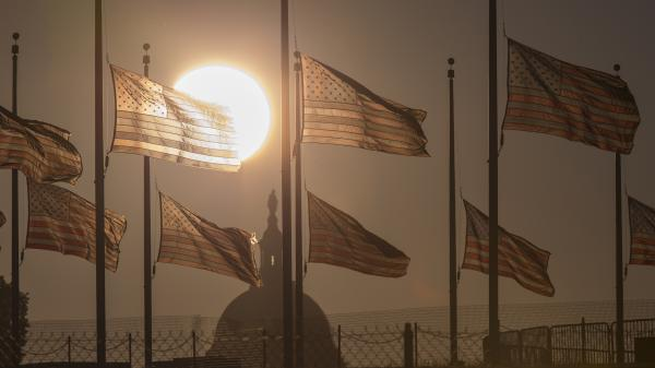 Flags fly at half-staff Tuesday after the deadly shootings at the Navy Yard in Washington, D.C.