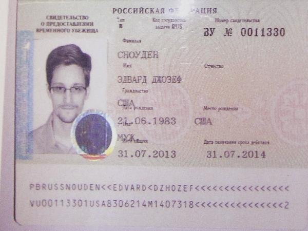 Government officials tell NPR that Edward Snowden's job responsibilities allowed him to copy sensitive files unnoticed.