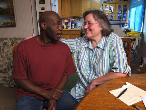 Bobby Harper, with his wife, Sherill, lives across the alley from Cobb. He says he was prepared to tolerate Cobb as long as he kept to himself, but he's angry now that Cobb has invited other white supremacists to join him.