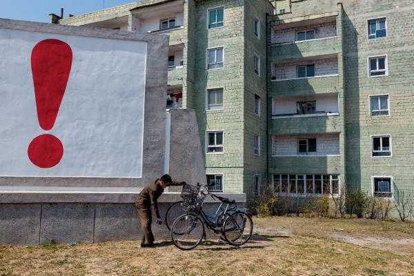 A man tends to his bicycle outside a housing complex in Kaesong, not far from the border with South Korea.