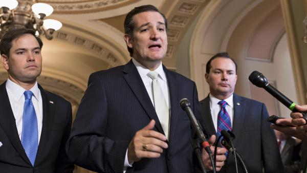 Sen. Ted Cruz, R-Texas, center, Sen. Marco Rubio, R-Fla., left, and Sen. Mike Lee, R-Utah, express frustration on Friday after the Senate passed a bill to fund the government, but stripped it of language crafted by House Republicans to defund Obamacare.