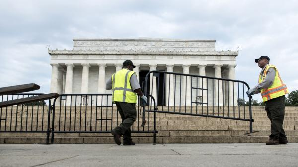 Members of the U.S. Park Service place barricades around the Lincoln Memorial on Tuesday in Washington, D.C. A partial shutdown of the federal government has led to the closing of national parks.