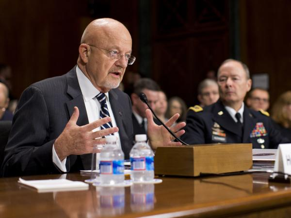 National Intelligence Director James Clapper (left), accompanied by Gen. Keith Alexander, the director of the National Security Agency, testifies on Capitol Hill Wednesday.