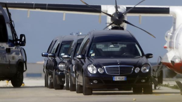 Hearses were waiting Friday outside a hanger at the airport in Lampedusa, Italy, where the bodies of victims from Thursday's ship wreck were being held.