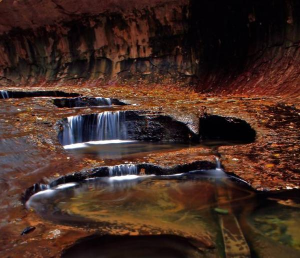 """An autumn scene in the canyon known as """"The Subway"""" in Zion National Park in Utah, which is now off-limits to hikers and other tourists due to the government shutdown."""