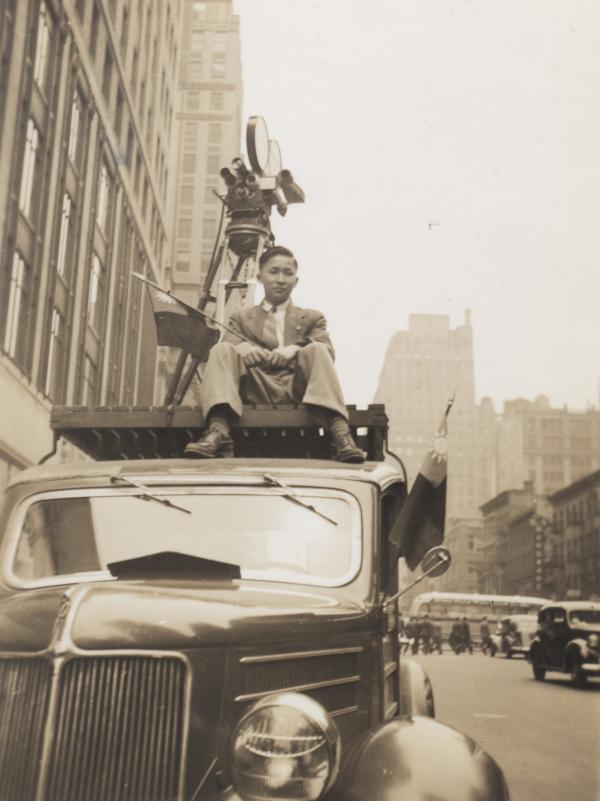 Harold Lee's son Henry, perched on the roof of a camera truck, helped produce and import Chinese-language films from Hong Kong and China in the late 1940s.
