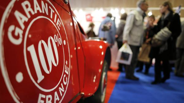 People walk past a Citroen 2CV vintage van at the Made In France fair in Paris on Sunday.