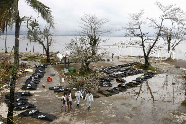 Bodies of the victims of Typhoon Haiyan are placed on an empty piece of land in Tacloban. The latest estimate from the government is that about 7 million people were affected by Friday's massive storm. United Nations officials put the figure at more than 9 million.