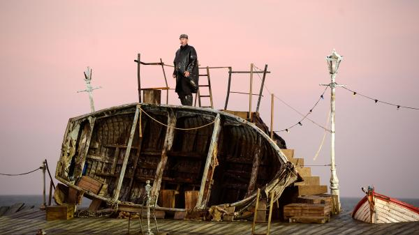 "A singer takes the stage during the first performance of ""Grimes on the Beach,"" an outdoor production of Benjamin Britten's opera <em>Peter Grimes</em>, on June 17, 2013 in Aldeburgh, England."