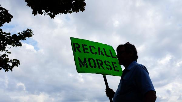 A man holds a sign advocating the recall of state Sen. John Morse in Colorado Springs, Colo., in September. Morse and a second state senator who backed the state's new gun control measures were recalled during a special election that month.