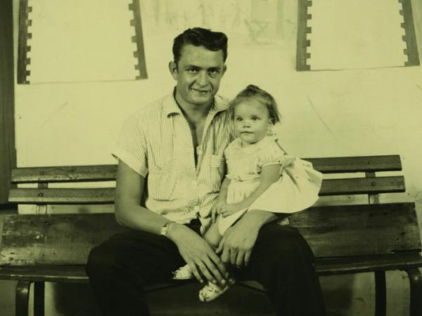 Rosanne Cash, seen here in 1956 with her dad Johnny, is one of many musicians featured in <em>Oxford American</em> magazine's winter issue on the music of Tennessee.