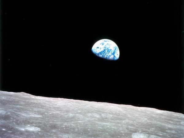 "The iconic ""Earthrise"" photo taken by astronaut Bill Anders through a window on the Apollo 8 command module on Dec. 24, 1968."
