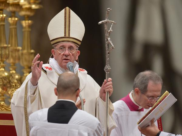 Pope Francis blesses the crowd at the Christmas Eve Mass at St. Peter's Basilica, on Tuesday at the Vatican.