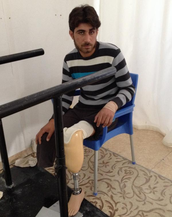 Syrian Mustapha Abu Bakr, 23, who was wounded in his country's civil war, prepares to take his first steps on prosthetic legs at a clinic in southern Turkey. The Syrian war has created a great demand for artificial limbs.