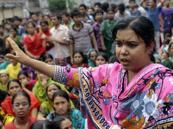 A Bangladeshi worker participates in a protest outside a garment factory in Dhaka.