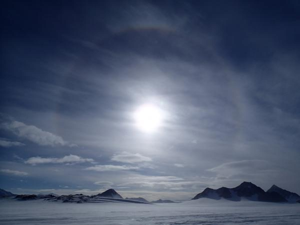When the air is thick with ice crystals, a rainbow ring can appear around the sun.