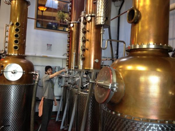 Mikel, a distiller at Dry Fly Distilling in Spokane, checks quality levels during the process.