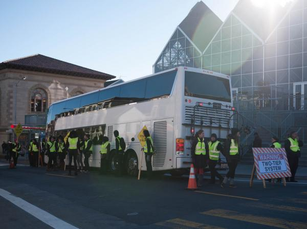 Protesters in San Francisco block a Google bus, which shuttles employees from the city to its location in Silicon Valley.