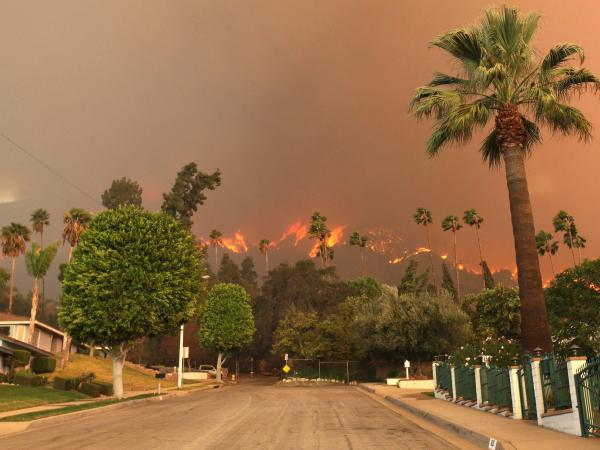 A wildfire burns in the hills just north of the San Gabriel Valley community of Glendora, Calif., on Thursday.