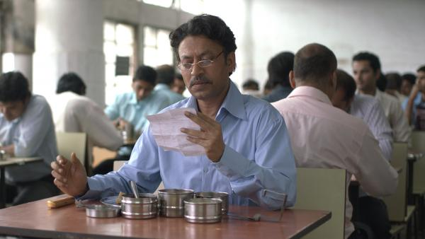 Through a delivery accident, Saajan Fernandes (Irrfhan Khan) begins a correspondence (and love affair) with a despondent housewife in <em>The Lunchbox</em>.