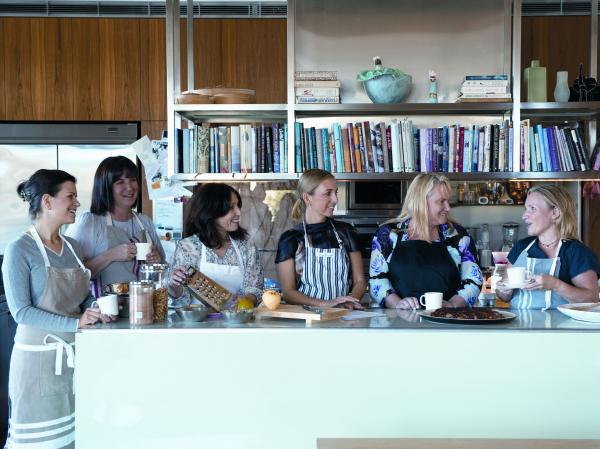 The Monday Morning Cooking Club gather round the kitchen table.