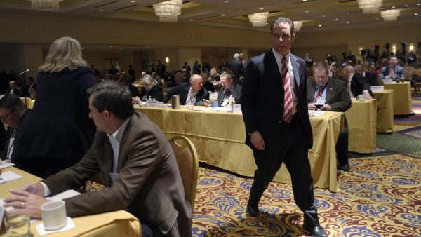 Republican National Committee Chairman Reince Priebus walks around the room Friday at the RNC winter meeting in Washington.
