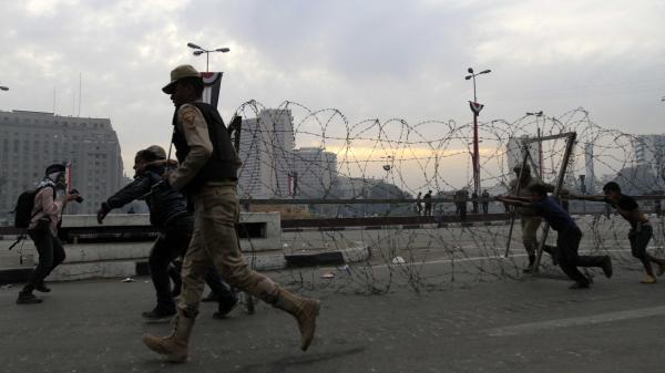 Egyptian security forces close Tahrir Square to disperse protesters in December.