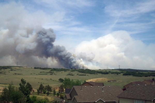 The Black Forest Fire as seen on June 12, 2013 from nearby homes. The wildfire became the most destructive in the state's history, surpassing 2012's Waldo Canyon Fire.