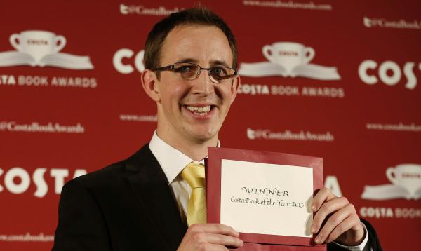 Costa Book of the Year author Nathan Filer poses with his prize for his debut novel Tuesday in London.