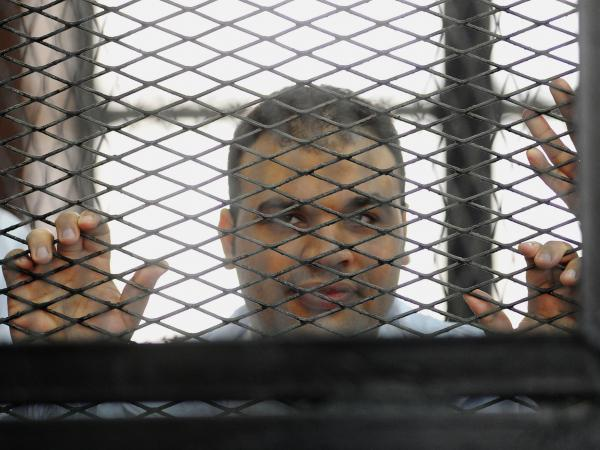 Mohammed Badr, a cameraman for Al-Jazeera, appears at a court in Cairo, on Dec. 4, 2013. He is among the journalists referred to the Egyptian criminal court Wednesday.