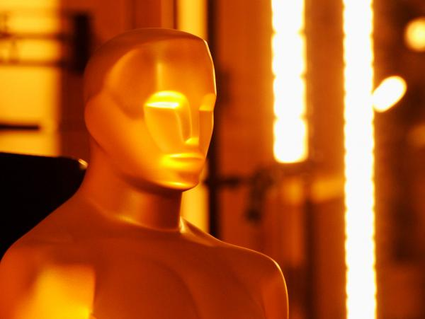 The Oscar statue is seen at the entrance of the Hollywood & Highland Center before the 2012 Academy Awards.