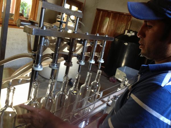 Edgar Gonzalez tries to fix bugs in the bottling machine before a state inspector comes to oversee their first batch of mezcal for export.