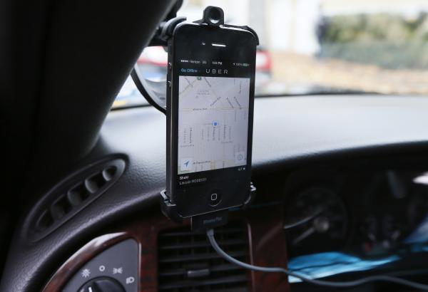 The transportation app Uber matches ride-seekers with drivers. Drivers must keep checking their phones to catch customers, and critics say that may have dangerous consequences on the road. Is Uber responsible for the risk?