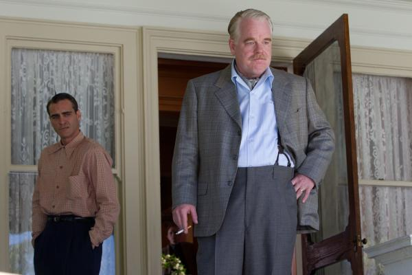 Joaquin Phoenix (left) and Hoffman in the 2012 drama <em>The Master</em>.