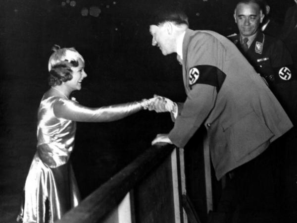Adolf Hitler shakes hands with Sonja Henie following her exhibition in Berlin in 1934.