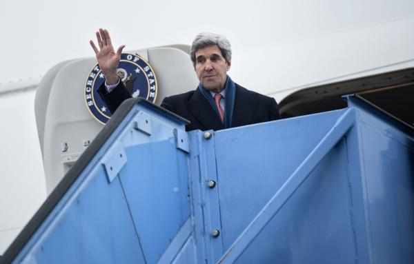 Secretary of State John Kerry waves while boarding his plane at Franz-Josef-Strauss Airport in Munich, Germany, on February 2, 2014.