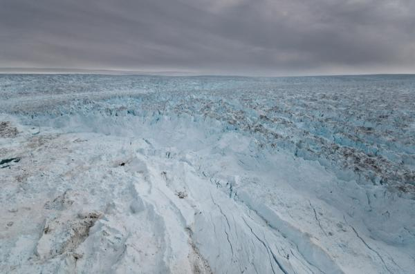 Massive sections of ice (center front) have broken away from the Jakobshavn glacier into the sea. There's enough water stored in Greenland's glaciers to raise the sea level by 20 feet.