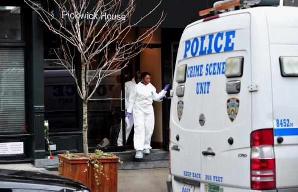 New York City Police Department investigators leave the apartment building of actor Philip Seymour Hoffman after he was reported dead on February 2, 2014 in the Greenwich Village area of New York. (Stan Honda/AFP/Getty Images)
