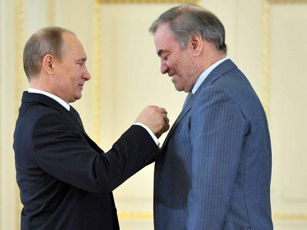 "Russian President Vladimir Putin (left) presents the ""Hero of Labour"" award to conductor Valery Gergiev, head of the Mariinsky Theatre."