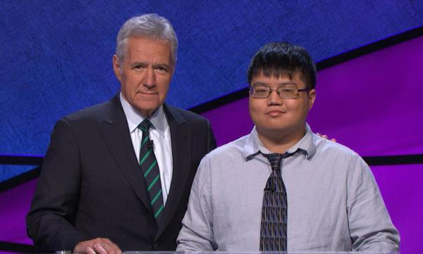 Jeopardy! host Alex Trebek and contestant Arthur Chu pose for a photo. (Facebook)