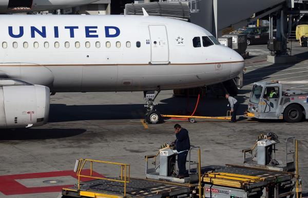 A United Airlines sits on the tarmac at San Francisco International Airport on January 23, 2014 in San Francisco, California. United Airlines parent company United Continental Holdings reported a surge in fourth quarter profits with earnings of $140 million compared to a loss of $620 million one year ago. (Justin Sullivan/Getty Images)