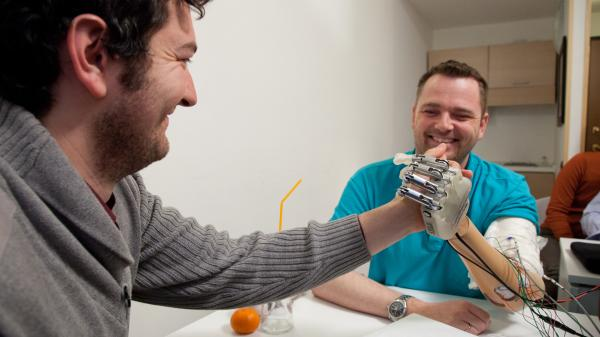 Dennis Aabo Sorensen tests a prosthetic arm with sensory feedback in a laboratory in Rome in March 2013.