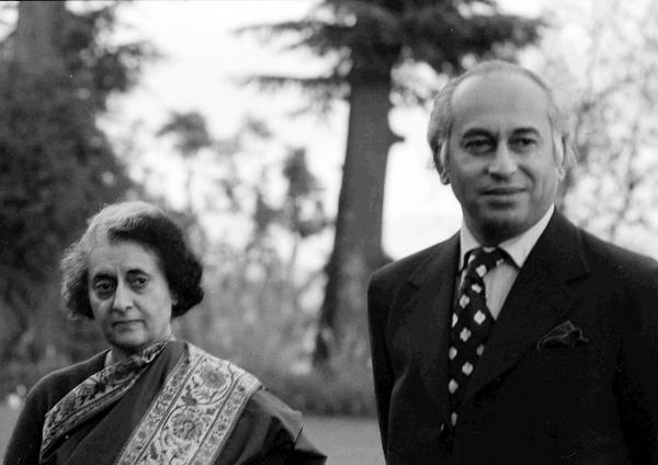 Pakistani leader Zulfikar Ali Bhutto stands with Indian Prime Minister Indira Gandhi before a summit in Simla, India, on June 28, 1972. Bhutto was overthrown in a military coup in 1977 and hanged two years later.