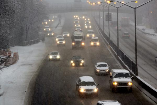 Cars travel down a highway during a snowstorm in the Brooklyn borough on February 3, 2014 in New York City. (Spencer Platt/Getty Images)