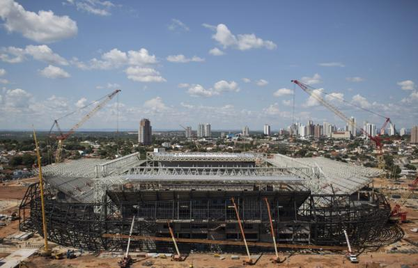 The Arena Pantanal stadium is under construction ahead of the 2014 World Cup soccer tournament in Cuiaba, Brazil, Thursday, Nov. 14, 2013. FIFA wants all World Cup stadiums completed by December. (Felipe Dana/AP)