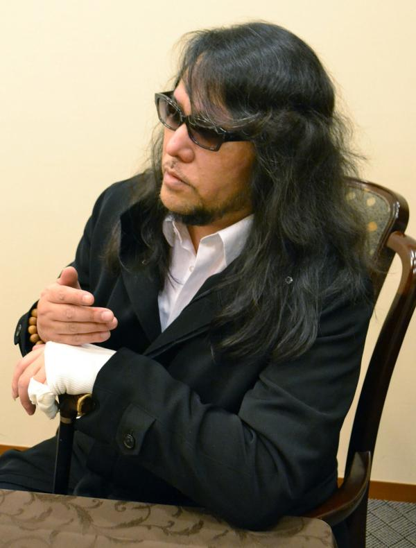 A December 2013 photo of Japanese composer Mamoru Samuragochi, who confessed Wednesday that he did not write the music that made him famous.
