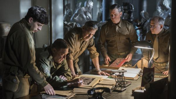 George Clooney (center) stars alongside Dimitri Leonidas, John Goodman, Matt Damon and Bob Balaban in the World War II drama <em>The Monuments Men, </em>inspired by the true tale of an Army unit charged with recovering art stolen by the Nazi regime.